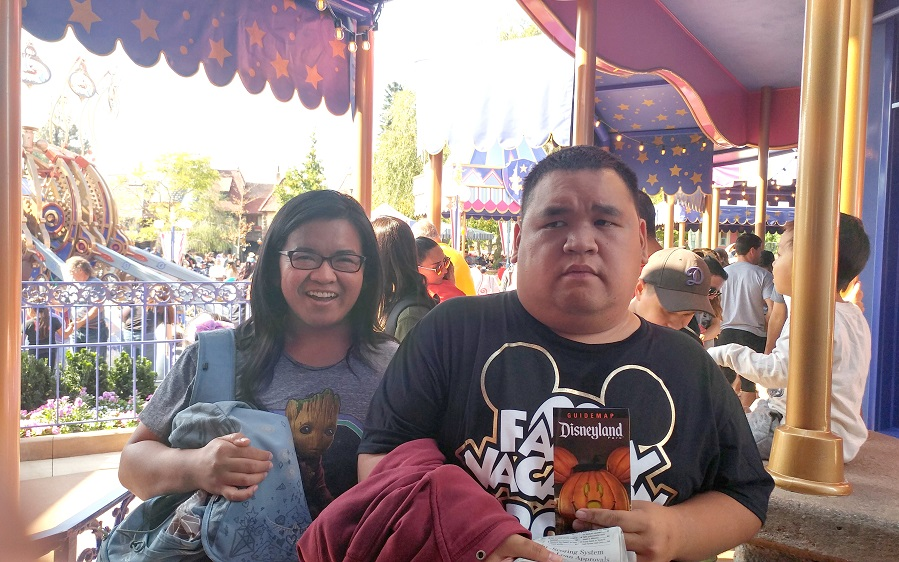 rochelle and robert in line for dumbo ride at disneyland